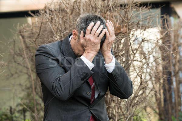 Zakenman depressie handen voorhoofd volwassen hand Stockfoto © AndreyPopov