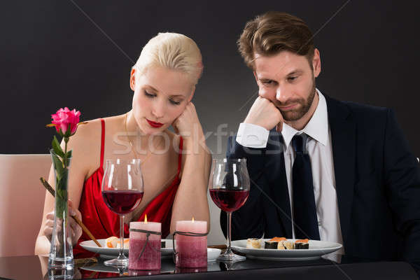 Sad Couple Having Dinner At A Restaurant Stock photo © AndreyPopov