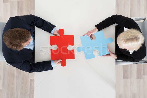 üzletemberek kapcsolódik kirakó darabok magasról fotózva kilátás kettő Stock fotó © AndreyPopov