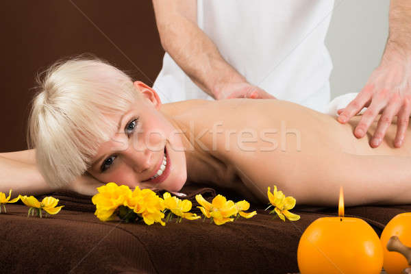 Stock photo: Young Woman Receiving Shoulder Massage
