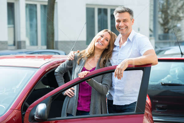 Happy Couple With New Red Car Stock photo © AndreyPopov