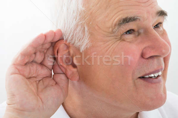 Senior Man Trying To Hear Stock photo © AndreyPopov