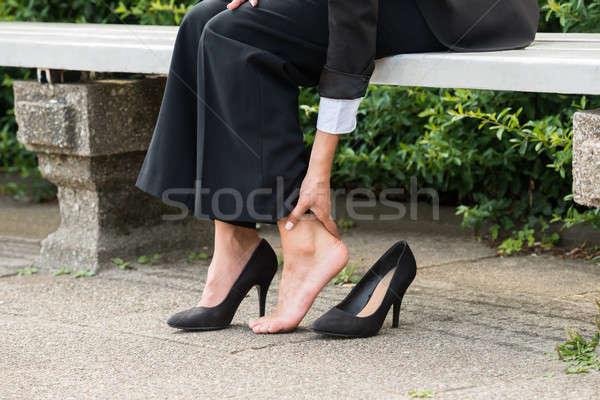 Businesswoman's Hand Removing High Heels Stock photo © AndreyPopov