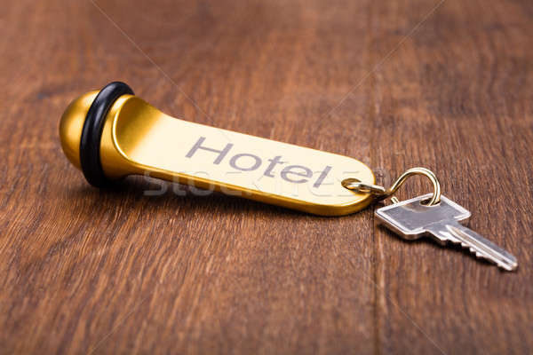 Stock photo: Hotel Key On Wooden Desk