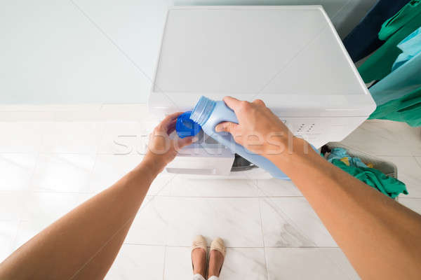 Person Pouring Detergent In A Lid Stock photo © AndreyPopov