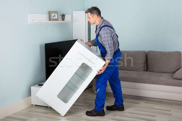 Mover Placing Furniture At Home Stock photo © AndreyPopov