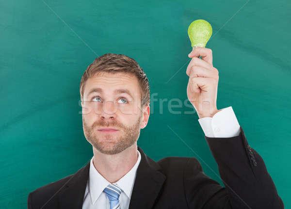 üzletember ökológiai villanykörte osztályterem portré fiatal Stock fotó © AndreyPopov