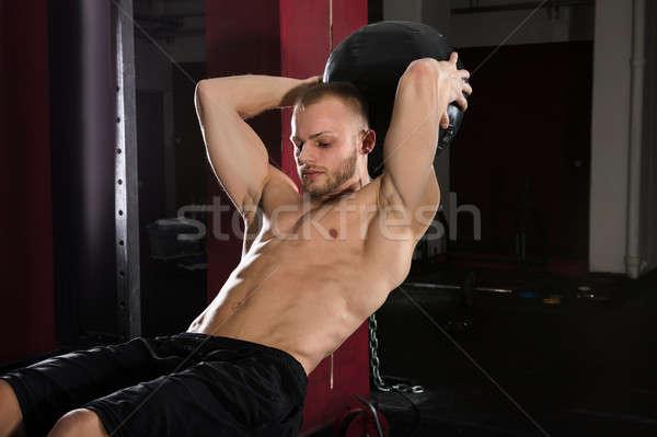 Man Doing Exercise Using Medicine Ball Stock photo © AndreyPopov