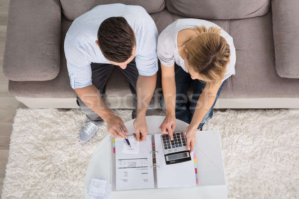Overhead View Of A Couple Calculating Bills Stock photo © AndreyPopov