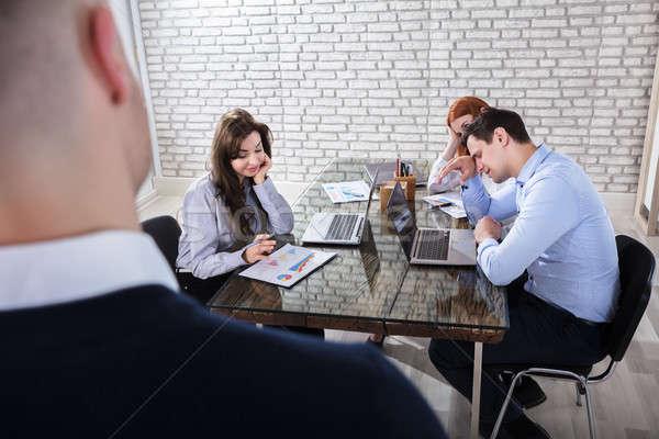 Tédio escritório reunião jovem local de trabalho Foto stock © AndreyPopov