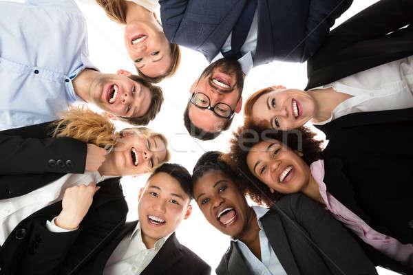Mosolyog üzletemberek áll fehér alulról fotózva kilátás Stock fotó © AndreyPopov