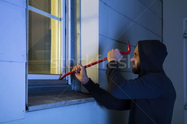 Robber Using The Crowbar To Open The Glass Window Stock photo © AndreyPopov