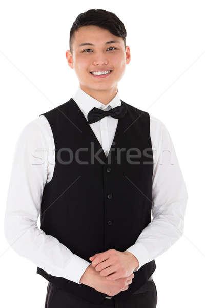 Portré fiatal pincér mosolyog áll fehér Stock fotó © AndreyPopov