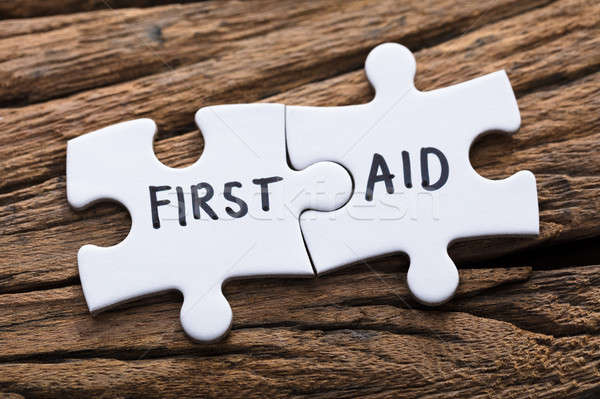Closeup Of Connected First Aid Jigsaw Pieces Stock photo © AndreyPopov