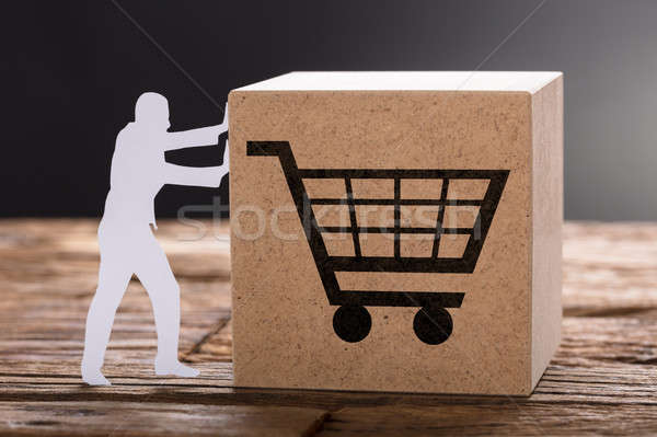 Paper Man Pushing Wooden Block With Shopping Cart Stock photo © AndreyPopov