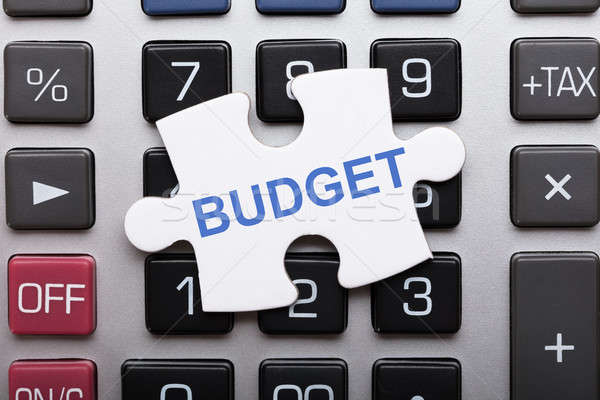 Jigsaw Puzzle Piece With Budget Text On Calculator Stock photo © AndreyPopov