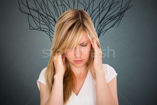 Close-up Of Stressed Young Woman Stock photo © AndreyPopov