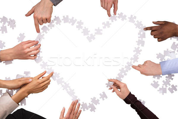 Stock photo: Group Of Hands Making Heart Shape With Jigsaw Puzzles
