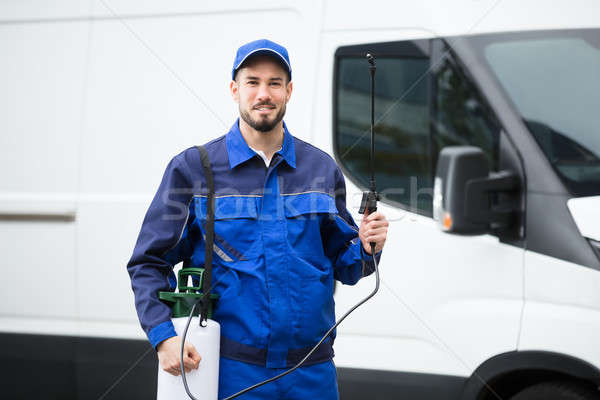 Portrait Of A Smiling Male Pest Control Worker Stock photo © AndreyPopov