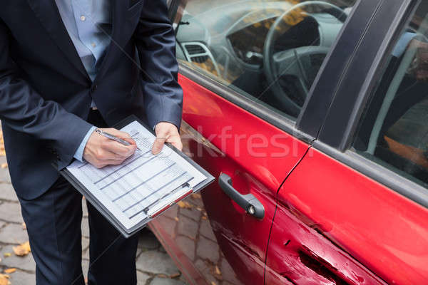 Insurance Agent Examining Car After Accident Stock photo © AndreyPopov