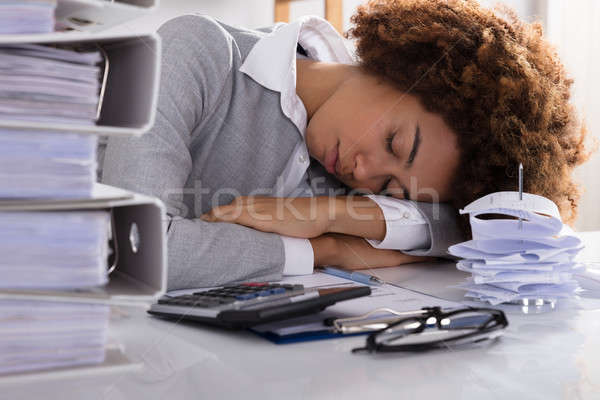 Stressed Businesswoman Sleeping In Office Stock photo © AndreyPopov