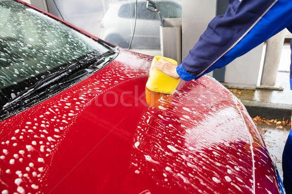 Lavoratori mano lavaggio rosso auto giallo Foto d'archivio © AndreyPopov