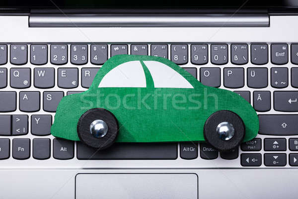 Green Car On Laptop Keypad Stock photo © AndreyPopov