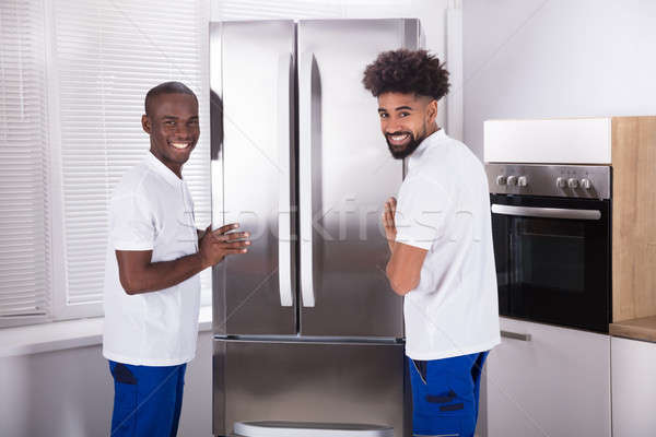 Twee mannelijke vriezer keuken uniform Stockfoto © AndreyPopov