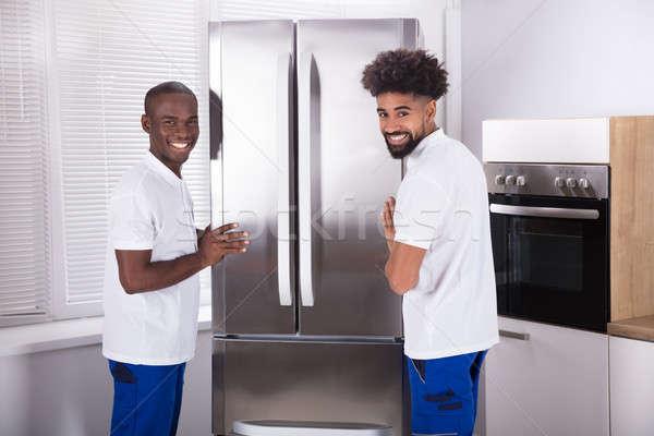 Due maschio congelatore cucina uniforme Foto d'archivio © AndreyPopov