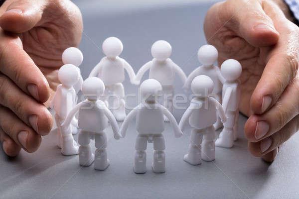 Személyek kéz miniatűr emberi közelkép üzlet Stock fotó © AndreyPopov