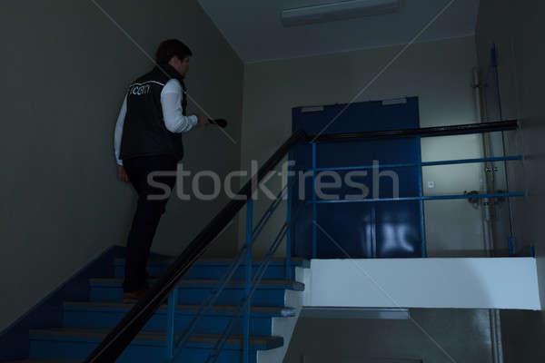 Güvenlik görevlisi yürüyüş merdiven el feneri Stok fotoğraf © AndreyPopov
