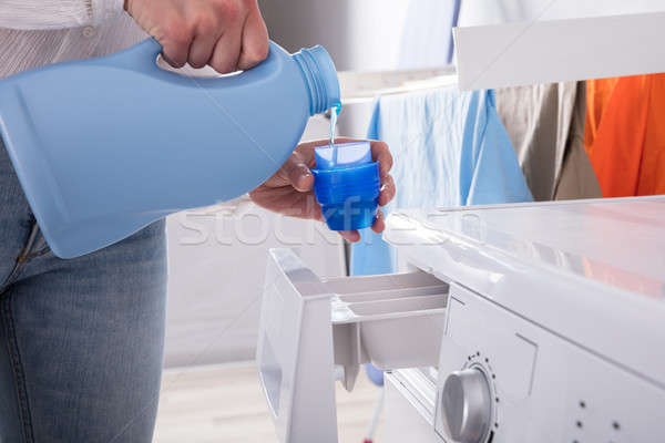 Person Pouring Detergent In Lid Stock photo © AndreyPopov