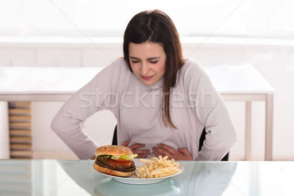 Young Woman Suffering From Stomach Pain Stock photo © AndreyPopov