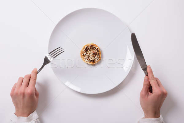 Woman's Hand With Fresh Food On Plate Stock photo © AndreyPopov