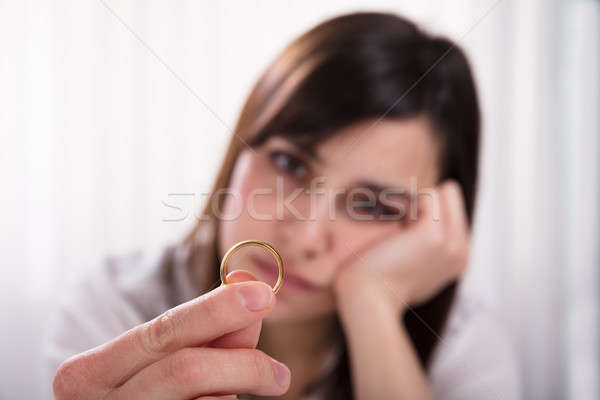 Woman Holding Wedding Ring Stock photo © AndreyPopov