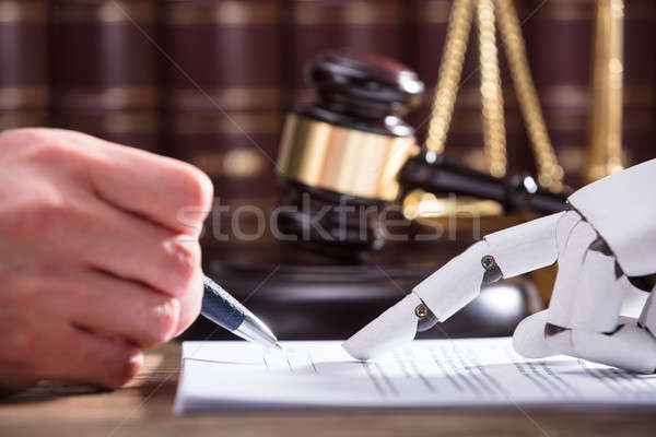 Robot Assisting Person In Filling Form Stock photo © AndreyPopov