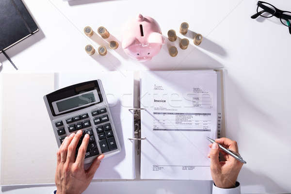 Elevated View Of Businessman Calculating Invoice Stock photo © AndreyPopov