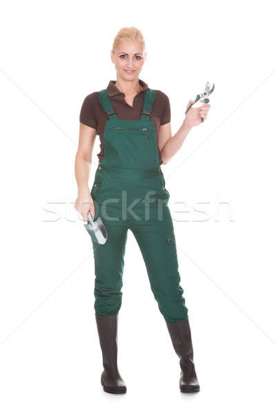 Portrait Of A Female Worker Holding Worktool Stock photo © AndreyPopov