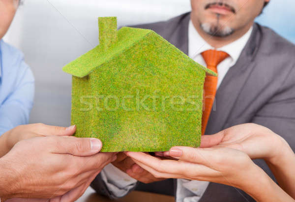 Businesspeople Holding Eco Friendly House Stock photo © AndreyPopov