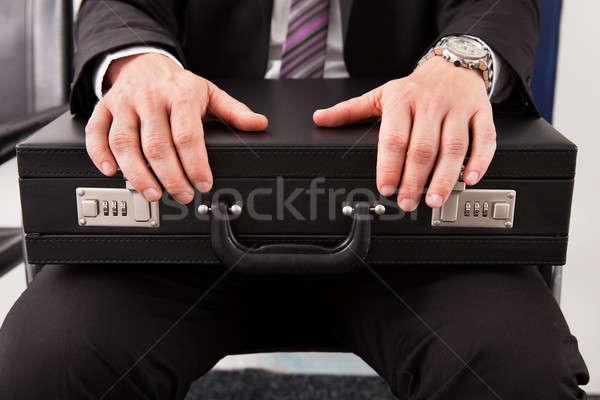 Empresário sessão pasta negócio Foto stock © AndreyPopov