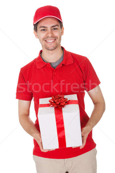 Haberci dekoratif hediye gülen genç Stok fotoğraf © AndreyPopov
