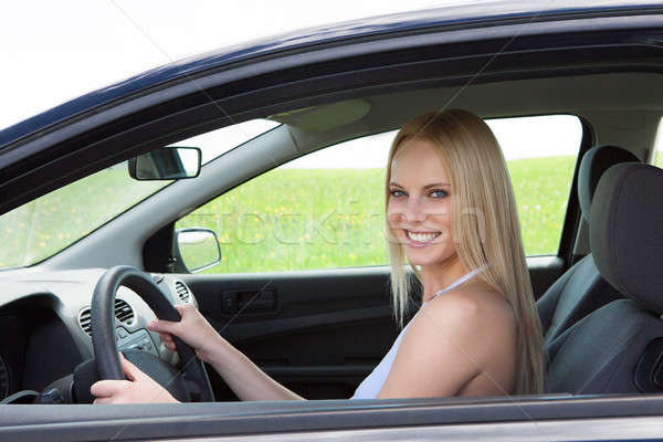 Happy Young Beautiful Woman Driving Car Stock photo © AndreyPopov