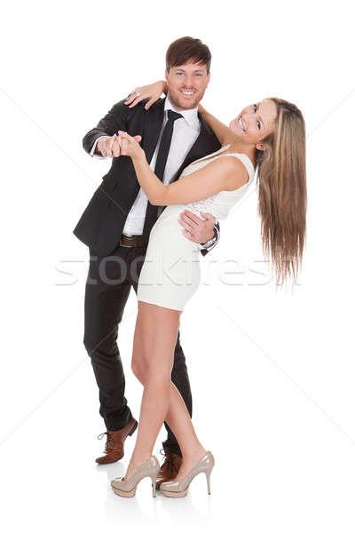 Fiatal elegáns pár tánc izolált fehér Stock fotó © AndreyPopov