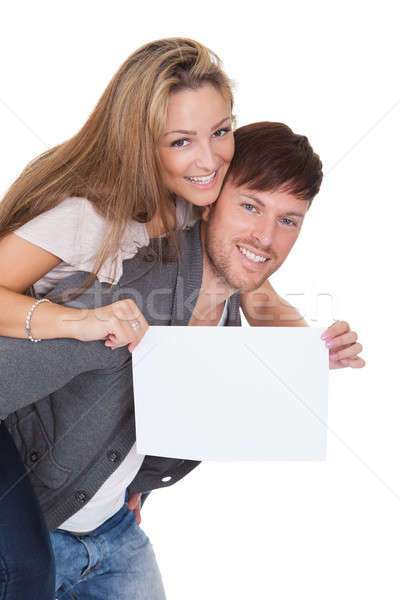 Woman getting a piggyback ride with blank sign Stock photo © AndreyPopov