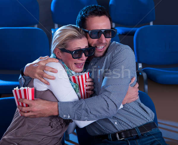 Couple reacting to a 3D movie Stock photo © AndreyPopov
