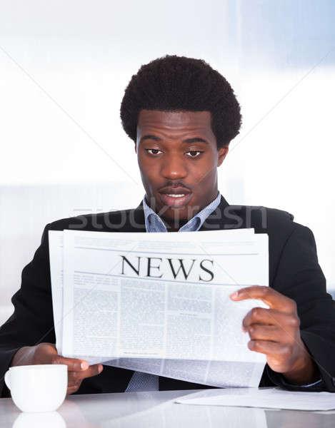 Empresário leitura jornal retrato escritório Foto stock © AndreyPopov