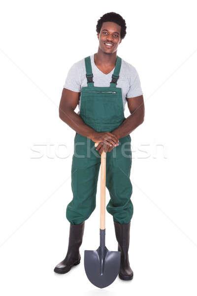 Jardinero pala feliz masculina blanco Foto stock © AndreyPopov