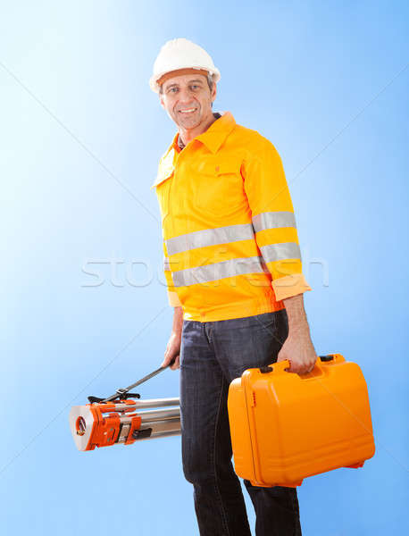 Senior land surveyor with theodolite equipment Stock photo © AndreyPopov
