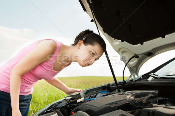 Woman Looking Under Hood Car Stock photo © AndreyPopov