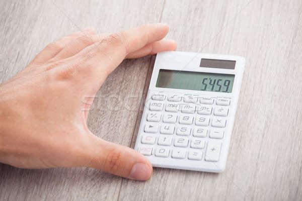 Kéz tart számológép közelkép asztal férfi Stock fotó © AndreyPopov